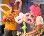 Tim Ezell tries to make a balloon animal with Silly Jilly the Clown